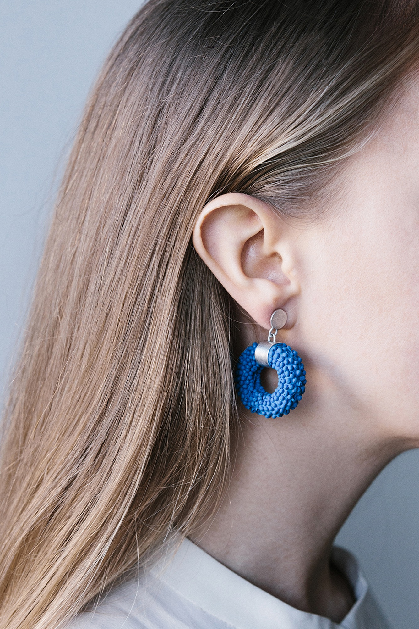 dovile b. nautilus silver silicone statement earrings