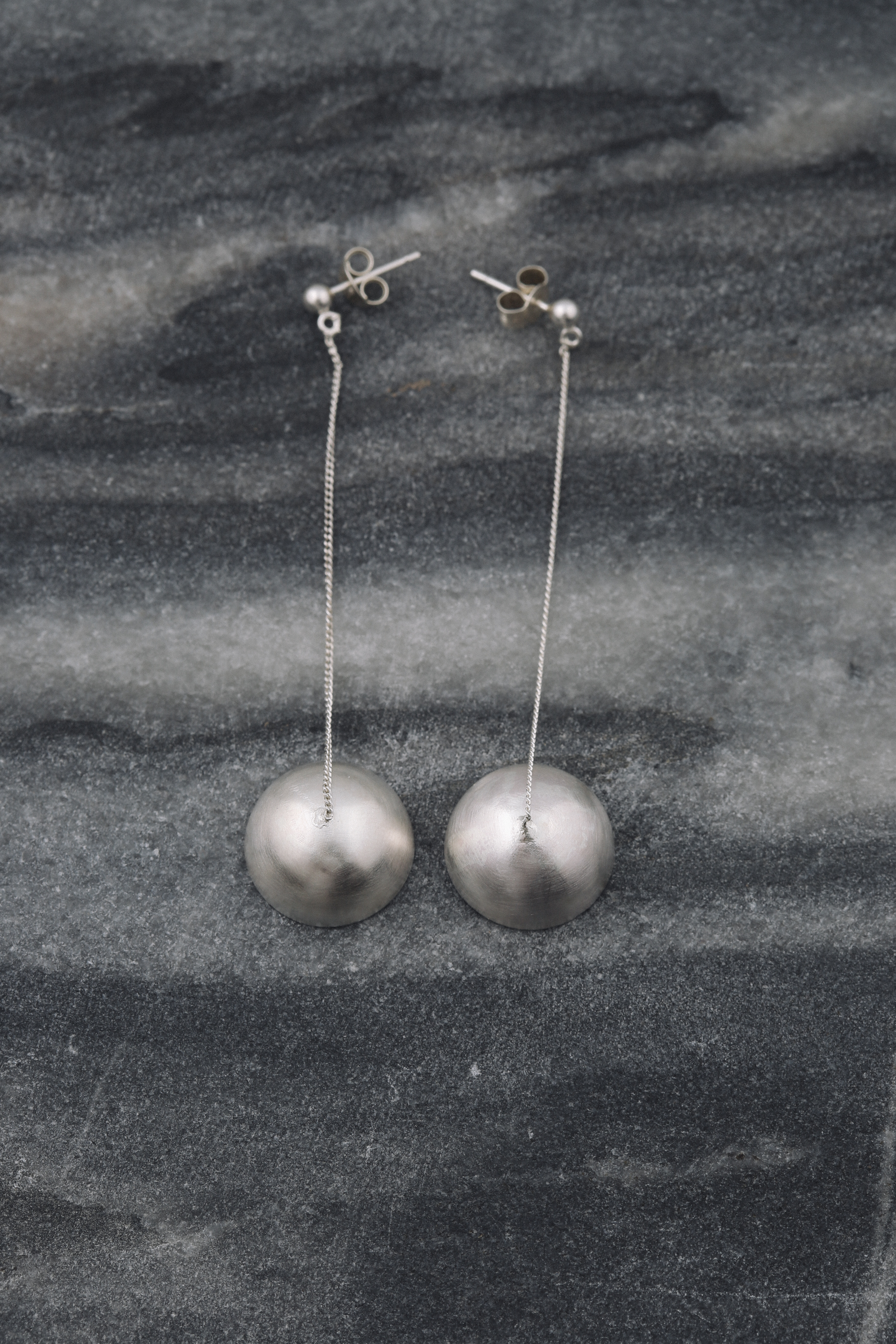 silver dome dangling earrings
